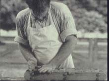 Pressing clay into a mold to make bricks - Used courtesy of Tom Walsh, Masonry Institute of St. Louis