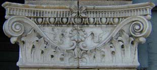 a pilaster capital made of two pieces of white terra cotta